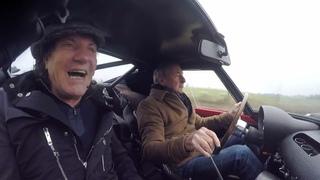 Nick Mason takes Brian Johnson for a ride in his Ferrari 250 GTO