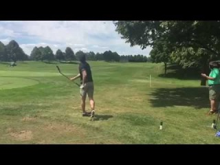 Tyler Seguin drives a golf ball with a hockey stick at the Canadian Open - NHL