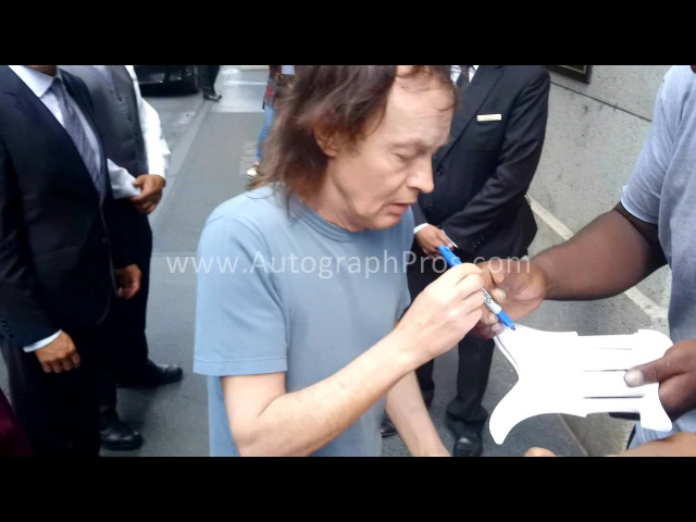 AC DC Angus Young Signing Autographed Guitar n Pickguards in NYC for AutographPros