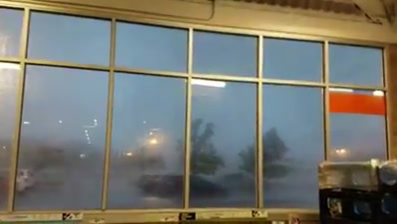 WOW An hour ago on the morning of June 24 2017 a tornado passing front of the store in Howell N J USA with sudden winds an
