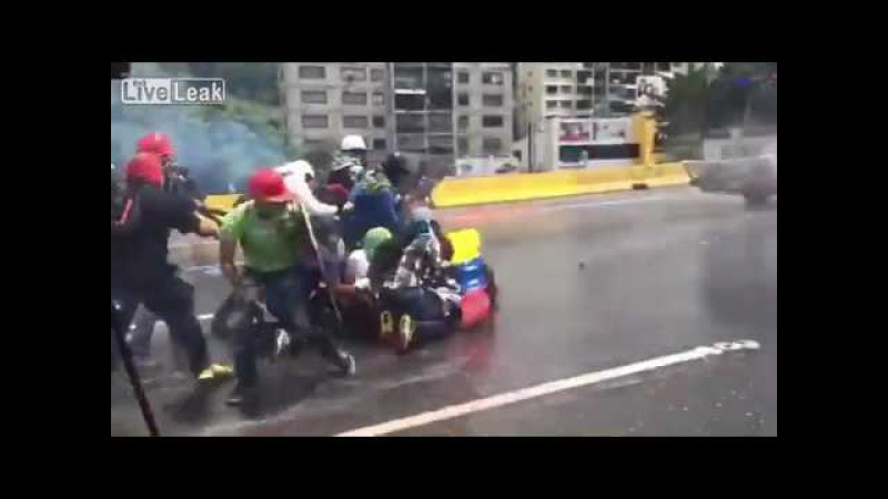 LiveLeakcom Venezuela protests The Whale water cannon sends people flying1