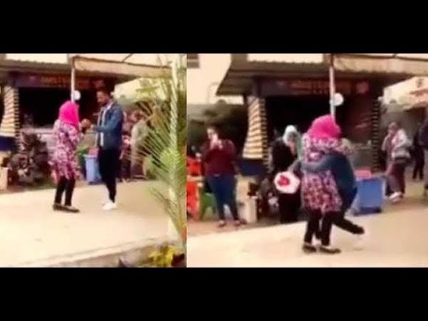 Female student expelled after she was filmed hugging a man