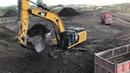 Cat 352F Excavator Loading Coal On Trucks