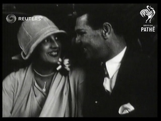 Jack Dempsey and wife shopping at Reville dressmakers (1925)
