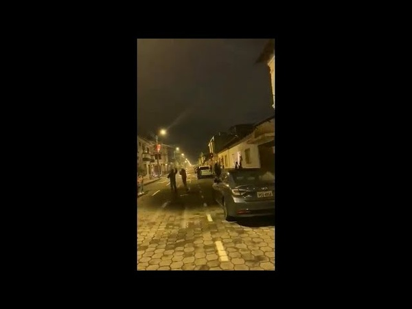 Possible cloaked UFO casting a shadow in the streets of Ibarra, Ecuador, Jan 1 (Disclose Screen)