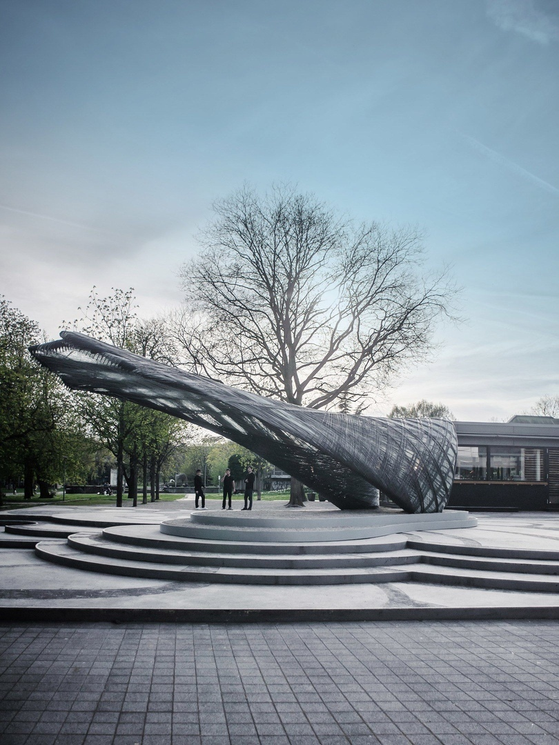 Drones and robots weave carbon-fibre pavilion based on moth webs