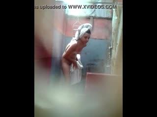 Spy young girl bathing