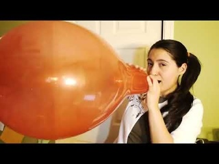 CHICK BLOWS A RED BALLOON